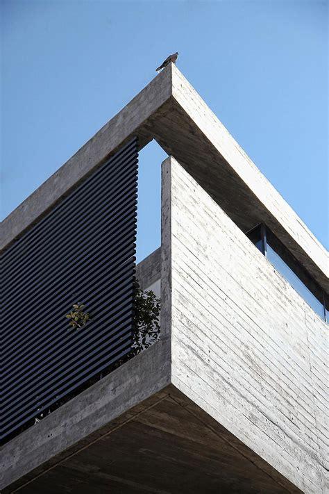 sleek athens house blends stone  concrete textures