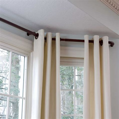 curtains on bay window bay window curtain rods for the home pinterest