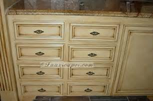 Faux finished antiqued kitchen cabinets