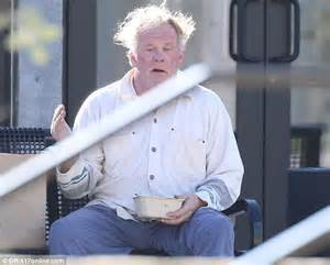 nick nolte cuts a dishevelled and surly figure in an