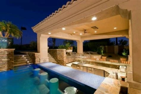 backyard pool bar swim up bar outdoor kitchen neutral outdoor living