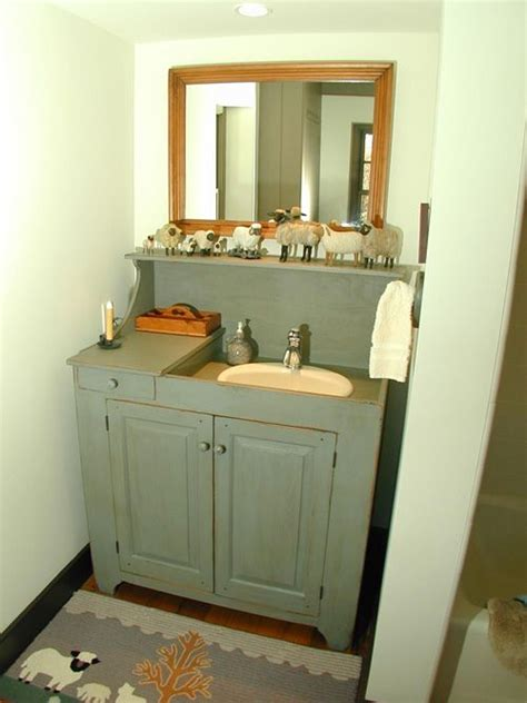 cabinet around sink would make out stand alone sink look