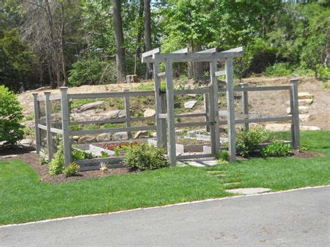 Garden Arbor Houzz A Fenced Vegetable Garden With An Arbor Is Located In The