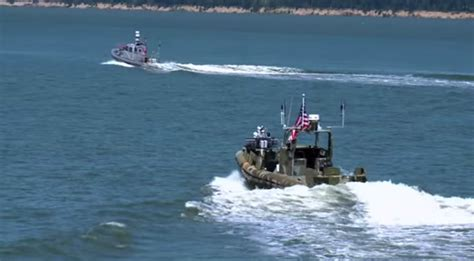 robot boat watch the us navy s swarm of robotic boats take to the sea