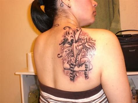 tattoo on shoulder healing black ink fairy tattoo on women right back shoulder