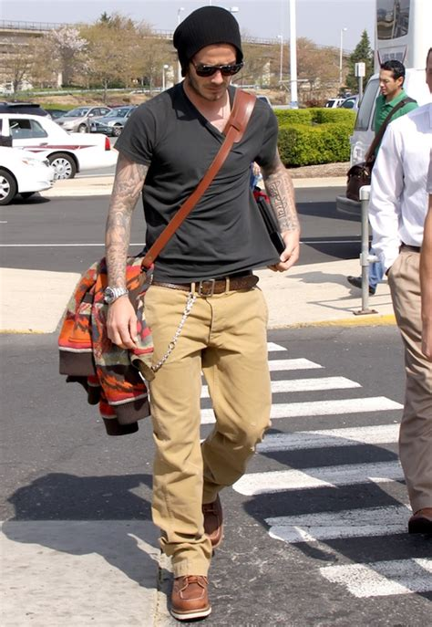 khakis and boots david beckham in ban sunglasses and wing classic