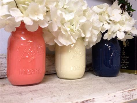 navy and coral wedding centerpieces painted coral white and navy jars for gifts