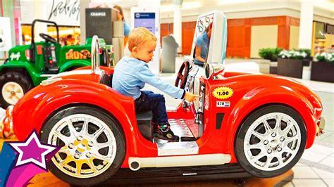 kid play car boy rides children cars at shopping mall car