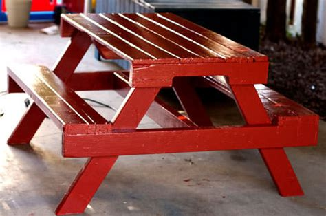 how to make a bench out of pallets 28 ways to repurpose old doors and pallets tip junkie