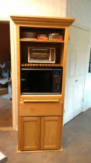 microwave pantry cabinet with microwave insert at