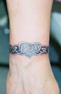 celtic wrist band with heart lions lair tattoo llc a tattoo