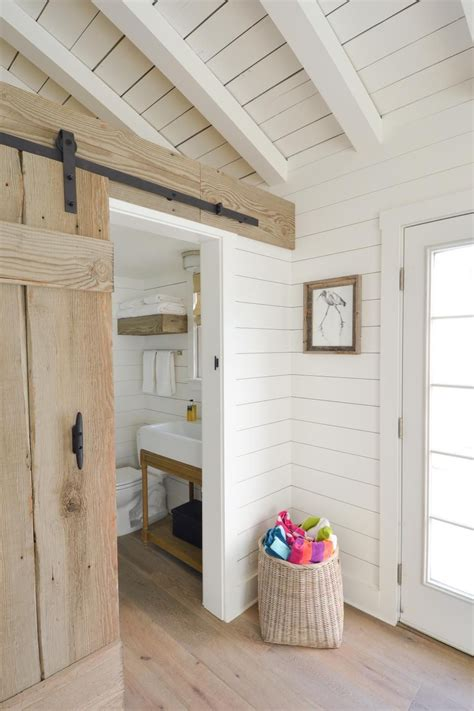 whitewashed wood panels cover the walls and ceiling of