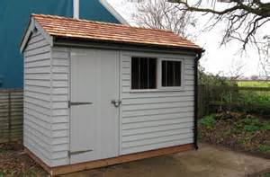 superior garden shed with weatherboard cladding with a
