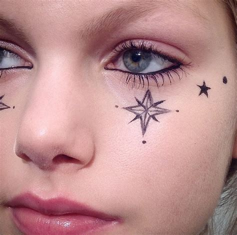 star tattoo under eye meaning near eye drawing on your with