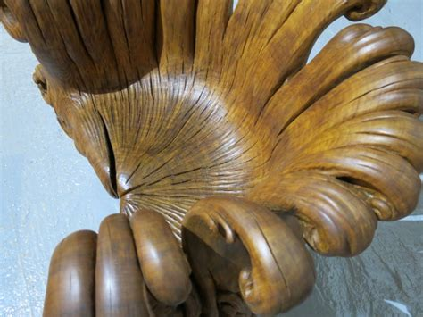 sculptor turns  single oak stump   comfortable chair