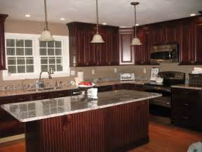 Granite With Cherry Cabinets In Kitchens Cherry Cabinets With New Caledonia Granite Countertops Here Are Some Pics Of Our Cabinets