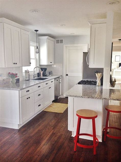 simple white galley kitchen traditional kitchen traditional kitchen with 2 in quartz countertop in alpina