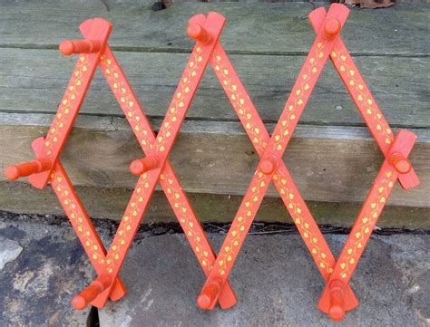 Expandable Peg Rack by Vintage Wooden Expandable Peg Rack Painted Orange With Yellow