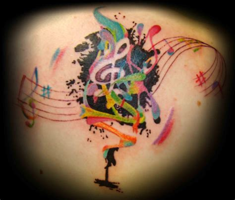 musical tattoo design colorful on back busbones