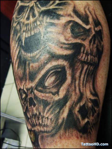tattoo pictures skulls demons demon skulls elbow tattoo