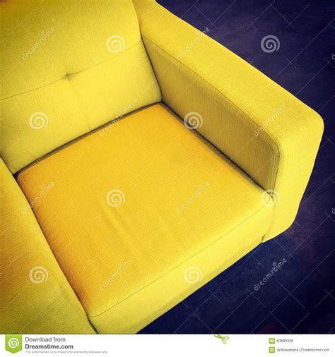 bright yellow armchair stock photo image 63889336