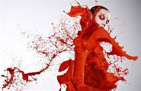 Hoodie Animal Merah models dressed in paint splashes by iain bored