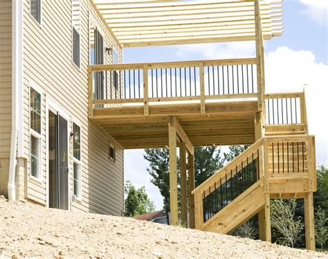 Elevated Covered Sundeck With Stairs Leading Down Into The Deck Building Designs And Plans Ideas