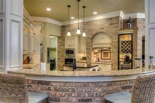 ordinary Concrete Kitchen Cabinets Designs #4: cream-traditional-kitchen-with-brick-breakfast-bar-and-brick-accent-wall.jpg