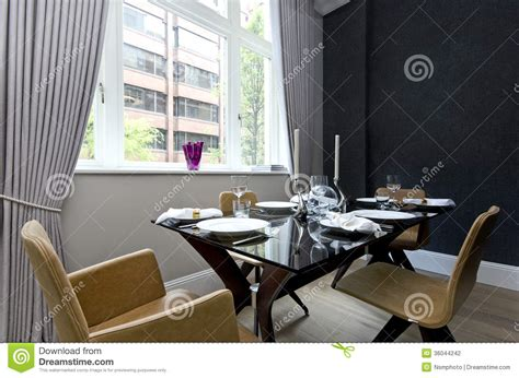 dining room set up modern dining room with dinner set up for four stock