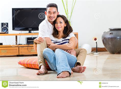 asian at home in their living room royalty free