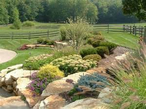 hillside landscaping up view of hardscape planters incorporated into the