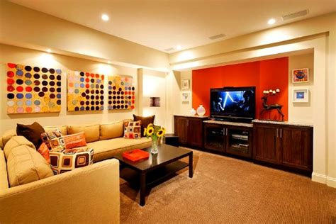 cheerful family room with orange and painting color
