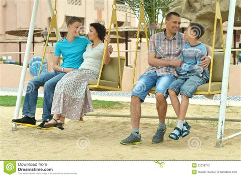 family swing happy family on a swing stock photo image 52038712