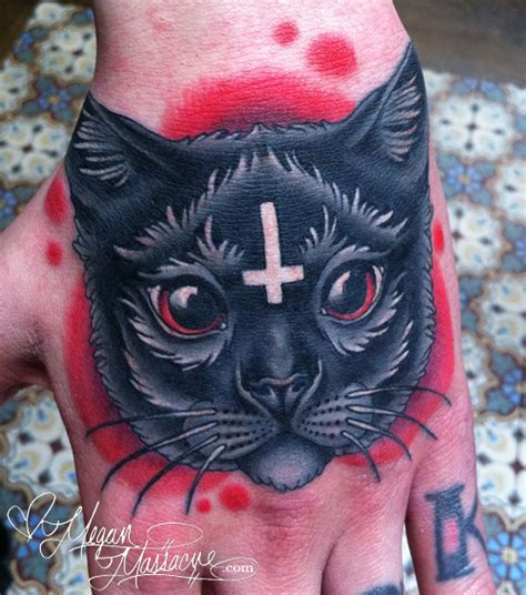 cat tattoo in hand tattoos megan massacre