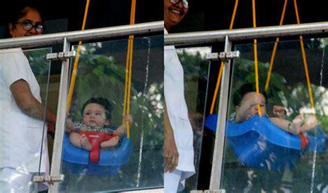 swing interracial taimur ali khan looks adorable while swinging in his
