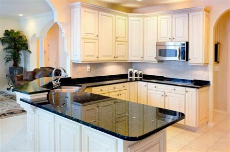 36 Inspiring Kitchens With White Cabinets And Dark Granite White Kitchen Cabinets Black Granite