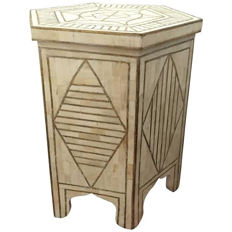 bone and brass inlay side table with geometric modern
