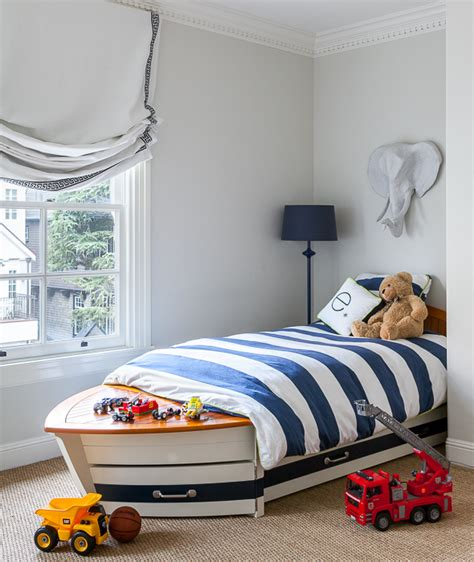 pottery barn boat bed blue and gray boy bedroom with bed under window