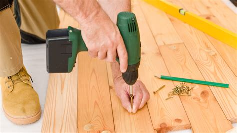 Small Home Improvement Loans Home Improvement Handyman Installing Wooden Floor Home