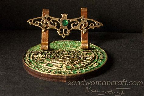 dollhouse miniature book stand with celtic wheel of the