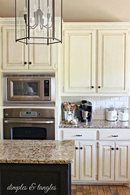 colored cabinets white subway tile backsplash