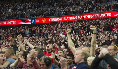united fans celebrate fa cup victory whilst