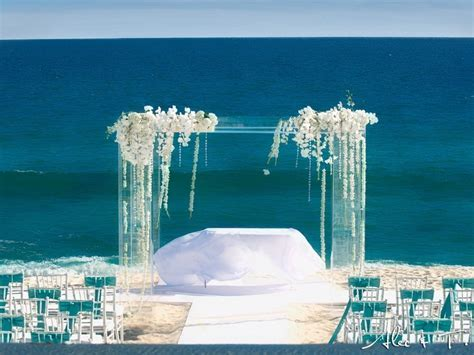 Lucite ceremony structure with draping white phalaenopsis