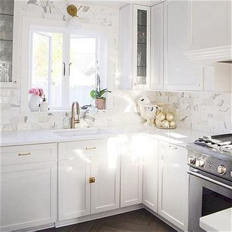 white knobs for kitchen cabinets white glass herringbone kitchen tiles by arizona tiles