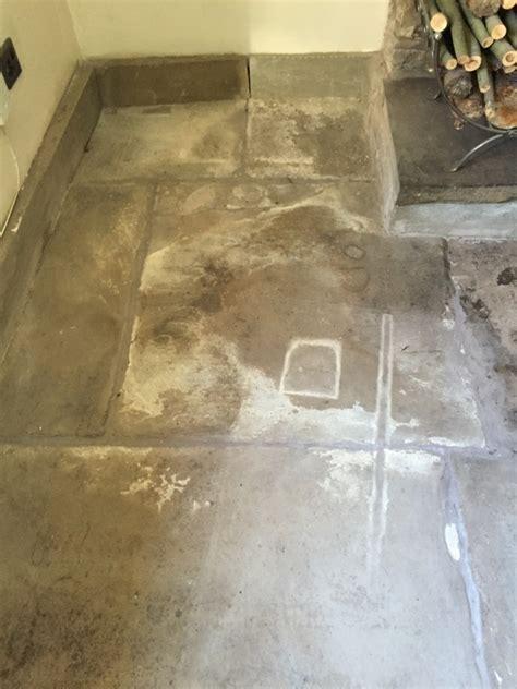 resurfacing and flaking sandstone flagstone floor in