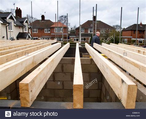 Self Building House Laying First Floor Timber Joists On House Floor Joists Construction