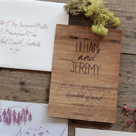 Home Interiors Kids earthy wood and floral wedding invitation from akimbo