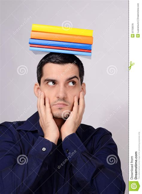 raising royalty books suspicious student holding a pile of books on his