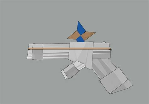 How To Make A Paper Pistol - make a paper gun that shoots paper and guns