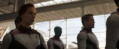 avengers wearing matching white suits